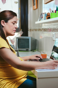 Woman working from home with laptop