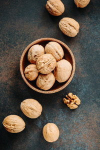 Top view on a heap of walnuts on a table