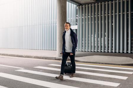 Man with suitcase walking