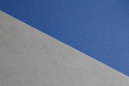 Abstract composition of blue and gray paper
