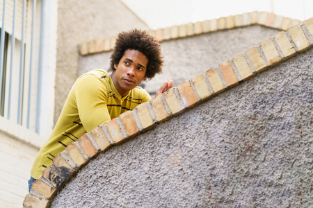 Black man with afro hair sightseeing in Granada