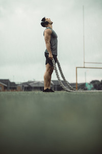 Man feeling energetic during battle rope workout