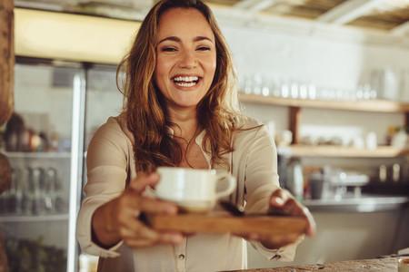Waitress serving a coffee