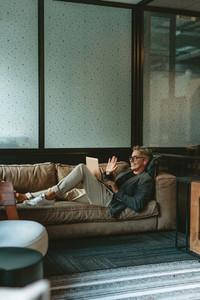 Mature businessman making video call