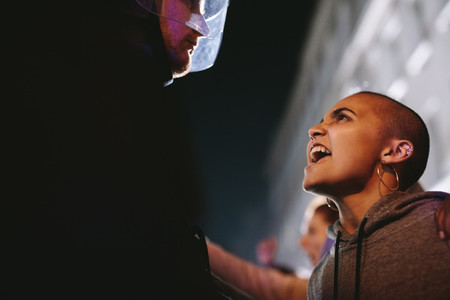 Woman demonstrating against police violence at night