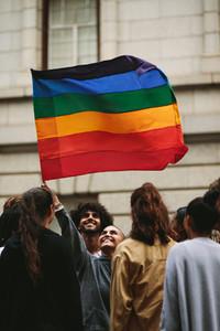 Happy parade goers in gay pride march
