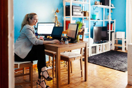 Woman teleworking in her house