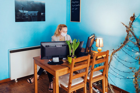 Woman teleworking in her house during biological quarantine