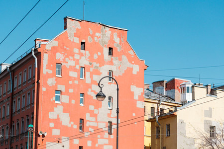 Old houses of European city Walls of pastel colors with restoration spots