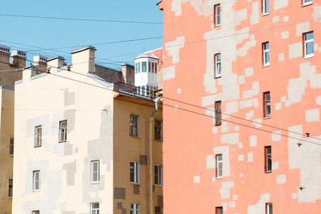 Old houses of European city Walls of pastel colors with restoration