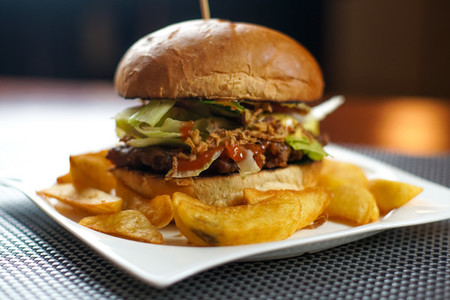 Hamburger and fries on a table