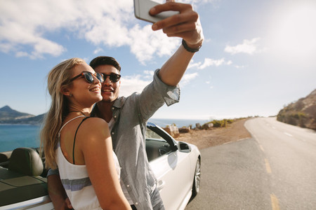 Couple making selfie photo on road trip