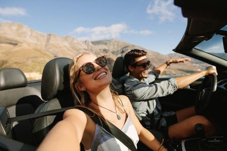 Beautiful couple enjoying on a road trip