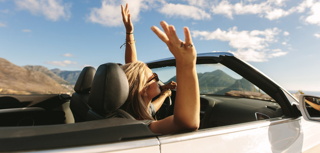 Couple on road trip enjoying in a cabriolet