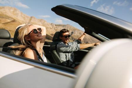 Couple having fun on a road trip
