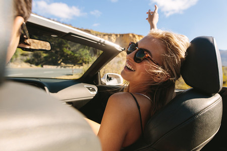 Woman enjoying on a roadtrip with her boyfriend