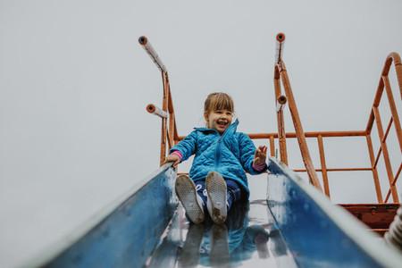 Girl sliding at playground