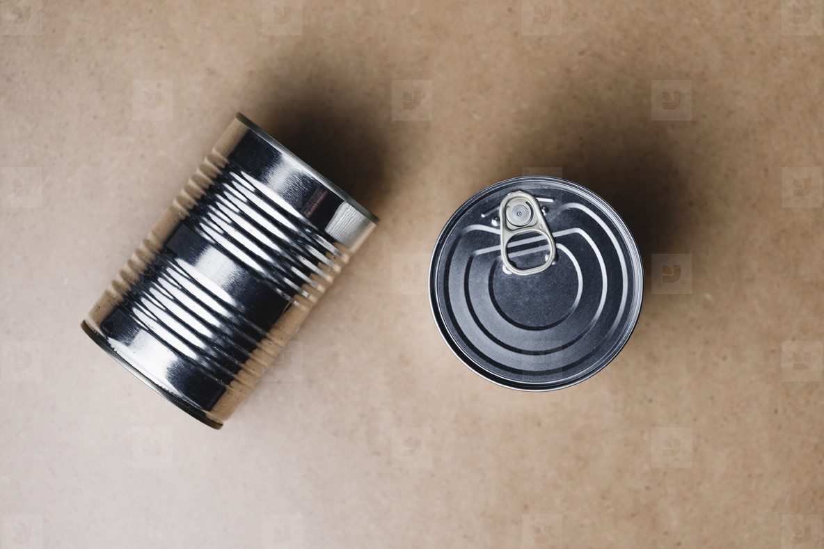 Top view on a canned food on a beige background  Minimal style food photography