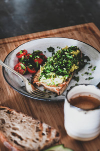 Healthy vegan breakfast with avocado toast and cup of coffee
