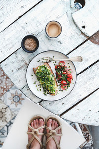 Food blogger making shot of healthy vegan breakfast top view