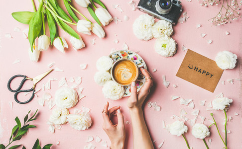 Coffee in female hands  flowers  film camera and sign happy