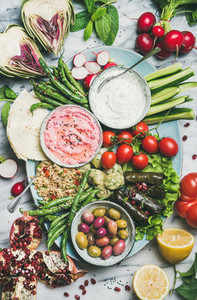Healthy vegan snack and dip set over marble table background