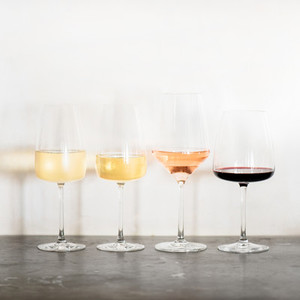 Variety of wine types over concrete table square crop