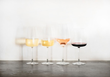 Variety of wine types over concrete table copy space