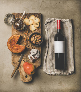 Wine and snack set with over concrete background  top view