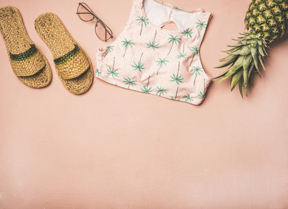 Variety of summer apparel fashionable items and fresh pinapple