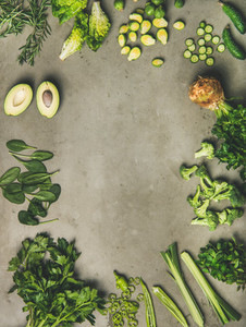 Flat lay of whole and cut vegetables and herbs copy space