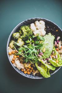 Healthy vegan superbowl and green smoothie on dark background