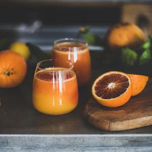 Glasses of fresh blood orange juice or smoothie  square crop