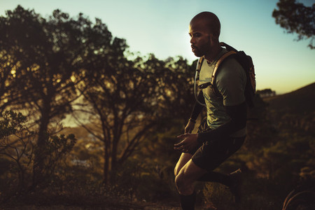 Trail runner practicing on mountain path