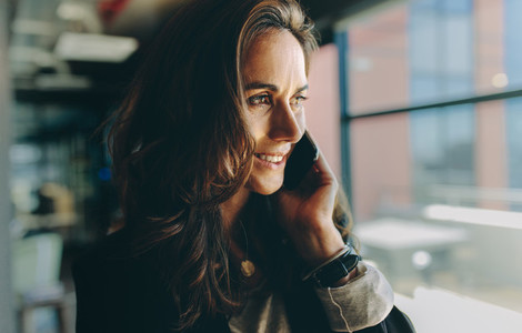 Smiling businesswoman on a phone call