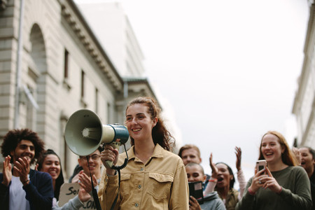 Woman with group of people in a rally