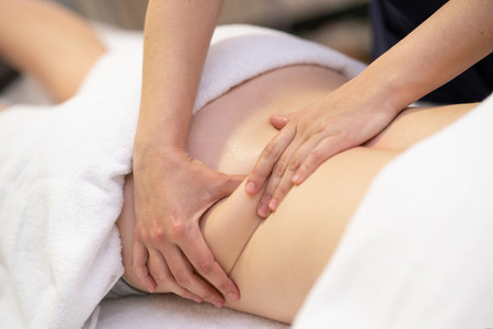 Young woman receiving a back massage in a physiotherapy center