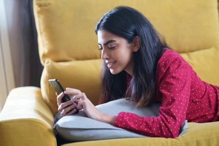 Persian woman at home using smart phone