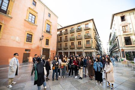 GRANADA  ANDALUSIA  SPAIN  DECEMBER  19TH  2020  Group of Japanese tourists watching the Cathedral of Granada