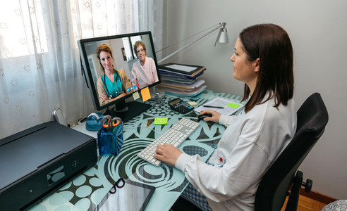 Woman talking on video call with her mother and doctor giving me