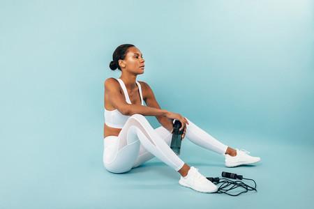 Tired woman in white sportswear