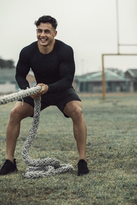 Man training with battle ropes