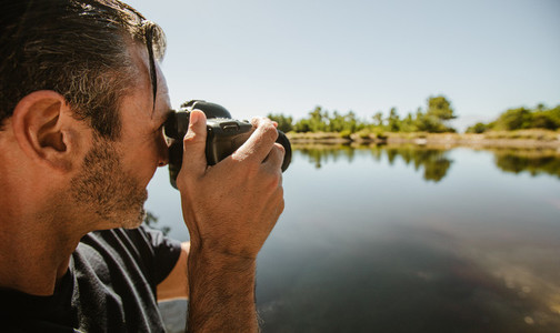 Wildlife photographer taking pictures of a lake