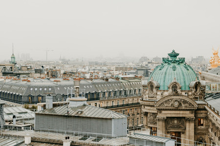 Aerial view of cloudy Paris with grey sky
