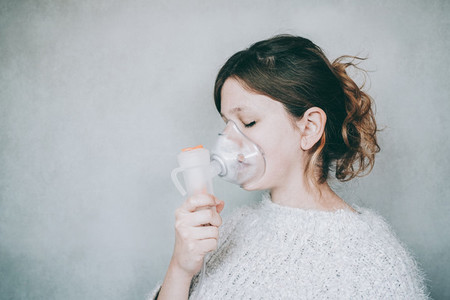 Young woman using a breathing mask