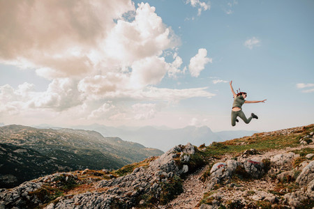 Young woman jumping in a mountain