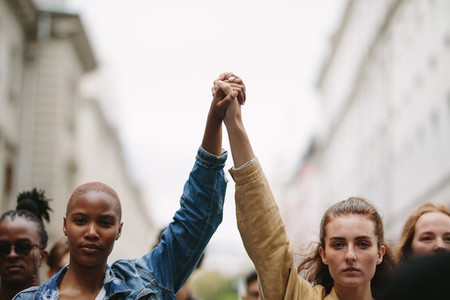 Group of activists with holding hands protesting