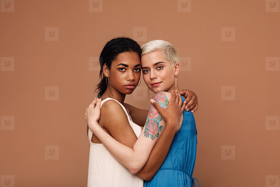 Two beautiful women embracing