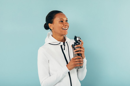 Happy woman in sports clothes