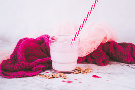 Delicious strawberry milkshake composition in pink and white
